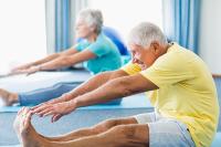 photo of senior couple stretching their legs