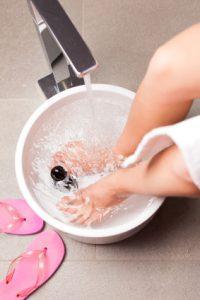 Woman having hydrotherapy water footbath