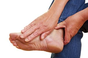 photo of a person rubbing their foot | American Foot & Leg Specialists