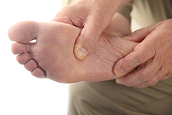 photo of a man checking his aching foot | Diabetic Nerve Pain