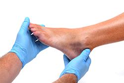 doctor examining a foot | American Foot & Leg Specialists