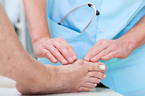 photo of patient getting their foot examined | bunion