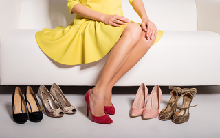 proper_fitted shoes | photos showing woman sitting on couch with a variety of shoes to try on