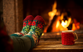 holiday feet | photo of feet in warm socks in front of fire